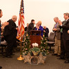 Greeting one another, center, are First Selectman Pat Llodra and Senator John McKinney, before sharing words at the podium during a swearing in-ceremony to welcome Newtown's new and reelected officials, including the incumbent first selectman. To their left is high school student Michelle Zarifis and Judge William Lavery. To their right are Selectmen Will Rodgers and James Gaston, and Town Clerk Debbie Aurelia Halstead. (Bobowick photo)