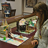 Cinderella's Castle in the Gingerbread House Contest is admired by creator Jocelyn Bazuro, who along with her mother, Kirsten, won second place in the family division of the contest. (Crevier photo)
