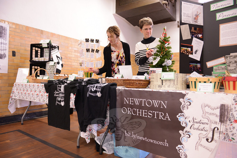 Parents Alison Cummings and Denise Rodriguez sell gifts at the Newtown Orchestra booth during the 28th Annual Holiday Festival. (Bobowick photo)