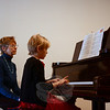 Kirsten Fallon plays for guests at the Victorian Tea Sunday, December 1. Behind her is Patsy Beddoe-Stephens. (Bobowick photo)