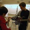 Newtown High School sophomore Dawson Goodrich, right, helped Sandy Hook School fourth grader Michael Spanedda during the first day of this year's High school Elementary Musicianship Mentoring Association (HEMMA) program. (Hallabeck photo)