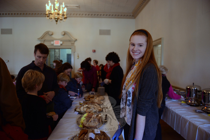 Cally Peterson serves guests at the Victorian Tea for the 28th Annual Holiday Festival. (Bobowick photo)