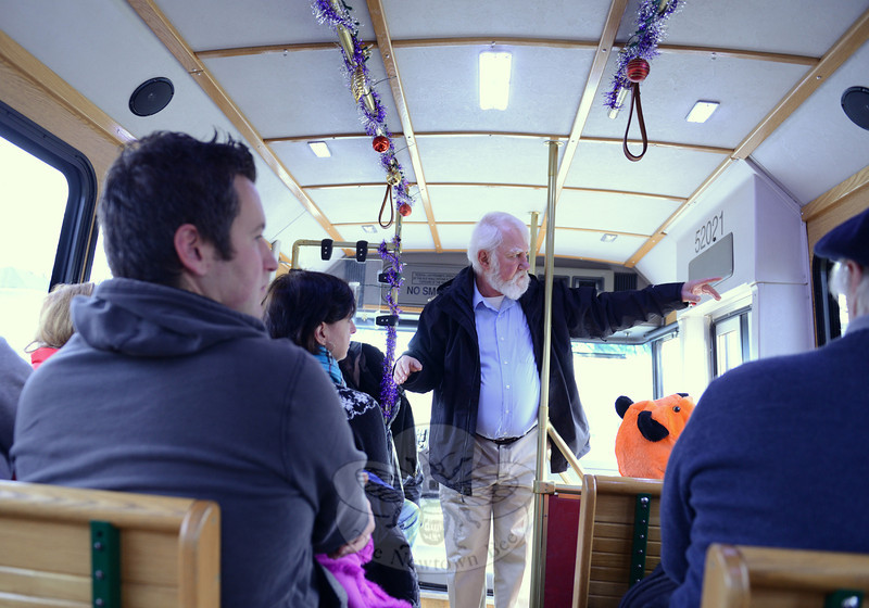 Town Historian Dan Cruson offers an oral history of Main Street during a trolley tour this year during the 28th Annual Holiday Festival. (Bobowick photo)