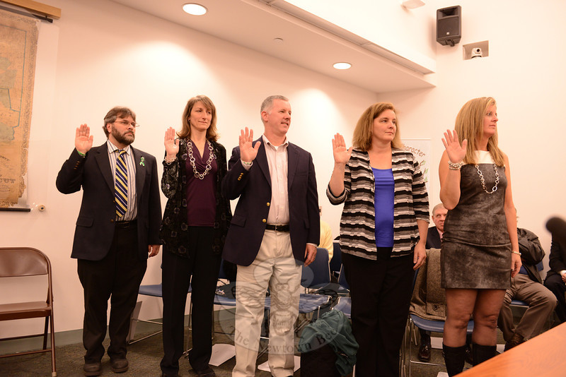 Raising their hands during a swearing-in ceremony are both new and reelected incumbent Board of Education members, from left, Keith Alexander, Michelle Embree Ku, David Freedman, Debbie Leidlein, and Kathy Hamilton. (Bobowick photo)