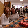 Newtown Youth & Family Services Executive Director Candice Bohr, right, and board member Jesse Rosenschein welcome guests to the craft fair during the 28th Annual Holiday Festival. (Bobowick photo)