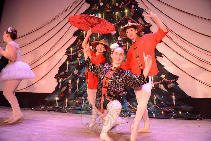 Monique Dubois, center, poses with Kylee Raiano, left, and Julia Finedan, during the 28th Annual Holiday Festival. (Bobowick photo)