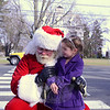 Clare Csaszar, 4, whispers Christmas wishes to Jolly Old Saint Nicholas (who is Joe Hemingway's doppelganger) Sunday, December 1. The 28th Annual Holiday Festival, benefiting Newtown Youth & Family Services, had something for everyone from historic trolley tours of Main Street, The Nutcracker Suite, a Victorian Tea, craft fair, caroling, to a moment's holiday magic with Santa Claus. Also taking place Sunday were the Festival of Trees and the Gingerbread House Contest at the C. H. Booth Library. (Bobowick photo)