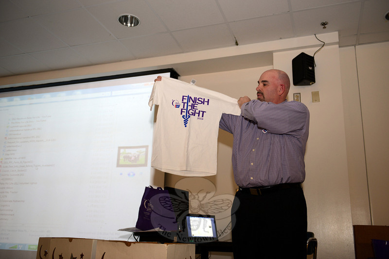 American Cancer Society representative Dave Andros holds up this year's Relay T-shirt with the message: Finish The Fight. (Bobowick photo)
