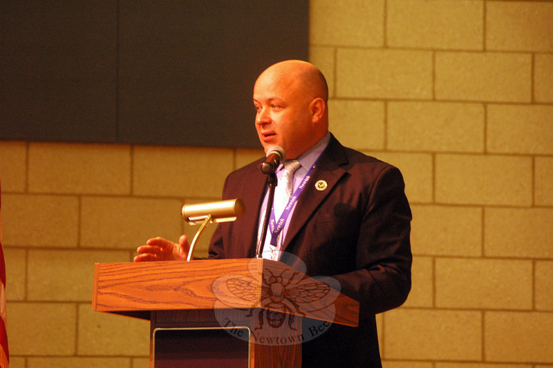 Newtown High School Principal Charles Dumais spoke during a ceremony held for students who have completed high school graduation requirements. (Hallabeck photo)