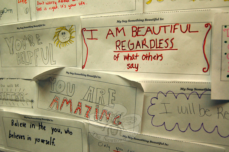 "A wall at Newtown High School was taken over by ""Say Something Beautiful"" words written by students prior to a Thursday, January 30, assembly featuring Say Something Beautiful Founder Traciana Graves. (Hallabeck photo)"