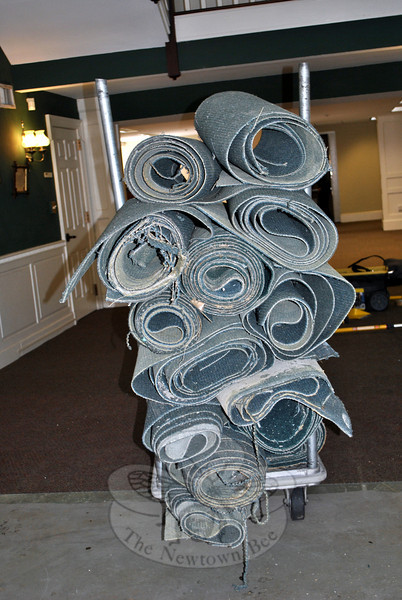 Damaged carpeting is rolled up and ready to be discarded at the C.H. Booth Library. The work of laying new carpet in areas damaged by the January flood waters, and areas badly worn, was nearly completed as of Monday, February 10. The library is looking at March 8 as a possible soft reopening date. (Crevier photo)