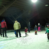 A Family Ice Skating Party, hosted by Newtown Parks and Recreation, was held under the pavilion at Dickinson Park on Friday, February 7. Parents and children both took to  the ice, some wearing skates for the event and others wearing sneakers. DJ Kevin Koschel (Music Man) provided music for the evening. Hot chocolate, hot coffee, and a small bonfire were also provided to offer some warmth during a cold evening. (Hallabeck photo)