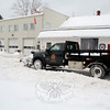 A Parks & Rec employee worked to clear the parking lot at Botsford Fire Rescue's station during a break between snowfalls on February 13. A three-part storm arrived early Thursday morning, the first of three weather events that brought snow, freezing rain, and ice to Newtown during the past week. Parks & Rec crews often supplement Public Works crews on plowing and other winter duties for the town. (Hicks photo)