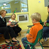 First Selectman Pat Llodra, seated left, read Should I Share My Ice Cream?, a book by Mo Willems, to children and parents gathered for a Bookworms Story Hour at Children's Adventure Center on Saturday, February 8. Mrs Llodra had some help from Sarah Jennings, seated second from left, to read. Between pages, Mrs Llodra involved the other gathered children by asking them questions connected with the book, like what their favorite ice cream is and whether they would share their ice cream with a friend. (Hallabeck photo)