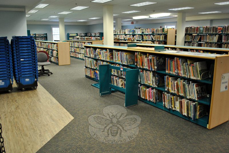 The Children's Department of the C.H. Booth Library, heavily damaged by the flood waters on January 4, is returning to normal. New carpeting and vinyl tile is in place, walls are painted, and ceil-ing tiles replaced. Storage boxes have been unpacked and books replaced on shelves, as the library moves toward an opening date of March 8. (Crevier photo)