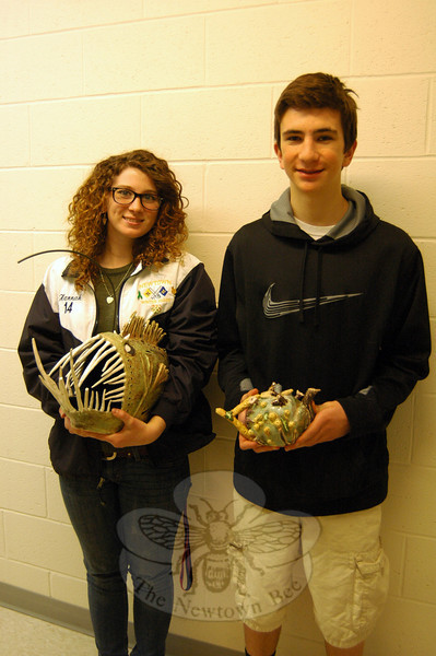 "Hannah Godbout, left, held her ""Angler Fish"" and Dawson Stout held his ""Sea Tea"" ceramic pieces on Friday, February 21, before each was shipped off to be part of the Annual National K–12 Ceramic Exhibition. (Hallabeck photo)"