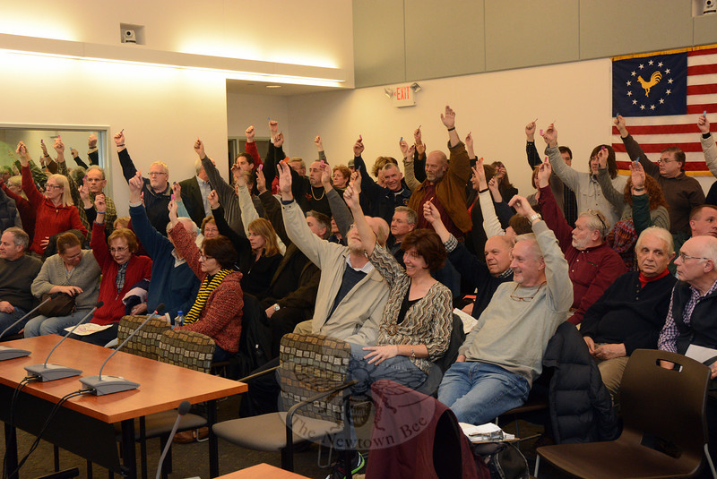 Approximately 100 people attended a 100-minute-long special town meeting at Newtown Municipal Center on February 26 to act on a $2.8 million bonding proposal for the expansion of the Hawleyville sanitary sewer system. When the voters were polled by a show of hands, the tally was 81-to-11 in favor of expanding the sewer system. (Gorosko photo)
