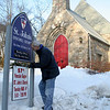 Members, and a few friends, of St John's Episcopal Church in Sandy Hook are planning to present their 57th Annual Shrove Tuesday Pancake Supper next week. Volunteers will be at the church all day on March 4, prepping the plates, napkins, utensils, drinks, pancake batter, griddles, coffee and everything else that will go into serving dinner for a few hundred people that evening. Diners will again enjoy an all-you-can-eat offering, with this year's menu to include fresh pancakes, country-style breakfast sausage, applesauce, and beverages. Donation is $9 for adults, and $4 for ages 3-10; children ages 2 and under are served free. Church Warden Bruce Moulthrop was at the church Monday afternoon, affixing a temporary event sign to St John's permanent church sign at 5 Washington Avenue. The Shrove Tuesday Pancake Supper will run from 5 to 7 pm. (Hicks photo)