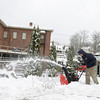 Michael Tobin clears snow from a walkway behind the Subway sandwich shop in Sandy Hook Center. (Bobowick photo)