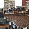 Electronics ruined by the January 4 flood at the C.H. Booth Library are stacked in one area of the library. Keyboards, monitors, computers, phones, and other electronics that make up the operating heart of the library must be replaced before the library can reopen to the public. (Crevier photo)
