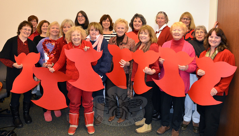 As in years past, many members of the Newtown VNA dress in red during February to commemorate National Heart Month. This was evident during a February 4 VNA gathering, which occurred on Women's Heart Health Day. Among those who attended at the Newtown Municipal Center were, from left, back row: Suzette LeBlanc, Krista Stringer, RN, Alice Falkowitz, Rebeka Dahlgard, Toni Catalina, Debby Osborne, Mary Tietjen, Mona Lauriolla; front row: Mary Steinfeld, Anna Wiedemann, Becky Smith, Mae Schmidle, Maureen McLachlan, First Selectman Pat Llodra, Carol Garbarion, Luella Leitner, and Newtown Health District Director Donna Culbert. (Voket photo)