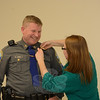 In January 31 ceremonies held at Town Hall South, town police Officer Jeffrey Silver, 36, took the oath of office to serve as a sergeant, having been promoted to that rank by the Police Commission on January 28. Town Clerk Debbie Aurelia administered the oath at the midafternoon event attended by police officers, town officials, and the family and friends of Sergeant Silver. Shown is Melanie Silver pinning a sergeant's badge on her husband's uniform. (Gorosko photo)