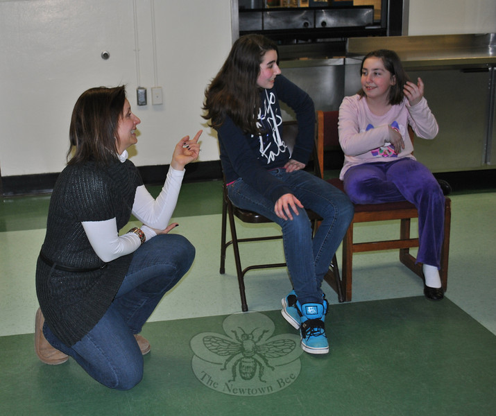 """Theresa Talluto, left, makes suggestions as Caitlyn Child and Sarah Flynn work through a """"Park Bench"""" exercise at a recent Theatre On Your Feet class. (Crevier photo)"""