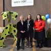 Kristin Chiriatti, president/founder of EverWonder Children's Museum welcomes supporters including First Selectman Pat Llodra to a brief dedication ceremony for the R. Hero metal sculpture recently installed at the museum's Peck's Lane location. The work by artists Karen and Tony Barone is designed to honor local firefighters and first responders, and was brought to Newtown through the underwriting support of Bunni and Rick Benaron. Sandy Hook Fire & Rescue member Shannon Hicks, pictured with Mrs Llodra and Ms Chiriatti, was on hand at the event representing local volunteers and responders.  (Voket photo)