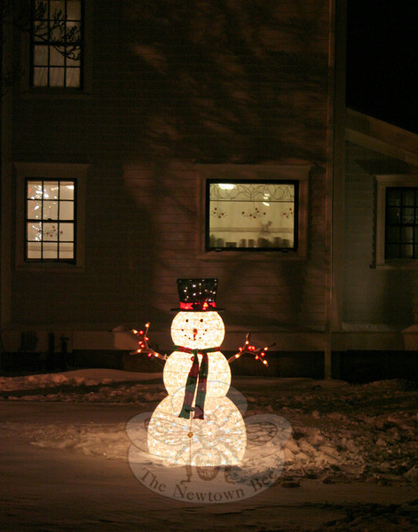 A lit snowman on Hawley Lane cast a glow on the first snow of 2014 last Friday night. By Monday, January 6, rain washed away much of the snow and left the region in a record-breaking — but seasonal — temperature drop. (Hicks photo)