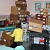 Children's Librarian Mimi Moron stacks boxes of items recovered from the water-affected areas of the Children's Department, in the dry Story Room, Wednesday morning, January 8, as remediation continues at the C.H. Booth Library. (Crevier photo)