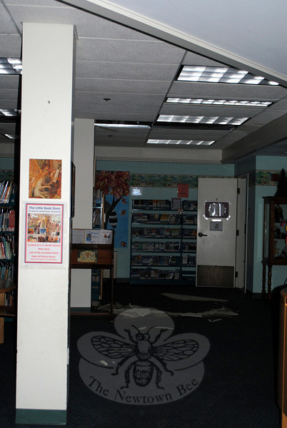 Ceiling tiles lay on the wet carpeting in the Children's Department of the C.H. Booth Library. While the library was occupied when the water damage occurred on Saturday, no one was hurt, and the building was quickly evacuated. (Crevier photo)