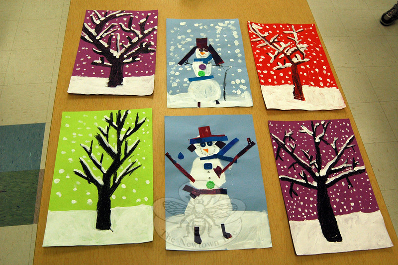 "Kindergarten students at Hawley Elementary School worked on making images of ""snowpeople"" on Tuesday, January 7, while first grade students were in the process of creating images of snow-covered trees. According to Hawley art teacher Vicki Sheskin, the first graders will also incorporate sentences describing ways the students care, an activity inspired by the school by Newtown's Core Character At-tributes tree, with their trees. (Hallabeck photo)"