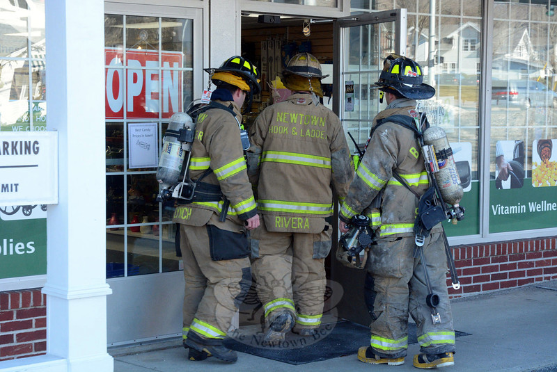 At 10:42 am on January 8, Newtown Hook & Ladder and Sandy Hook firefighters responded to Newtown Pharmacy & Surgical at 20 Church Hill Road on a report of an odor of gas in the building. An investigation indicated that a small refrigerator in the pharmacy had malfunctioned, releasing some refrigerant gas into the air, said Hook & Ladder Chief Ray Corbo. Firefighters ventilated the building. There were no injuries. About 17 firefighters responded. (Gorosko photo)