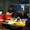 From left, C.H. Booth librarians Lucy Handley, Andy Forsyth, Alana Bennison, and Kim Weber work to salvage interlibrary loan materials, following water damage to the library that was incurred Saturday, January 4. (Crevier photo)