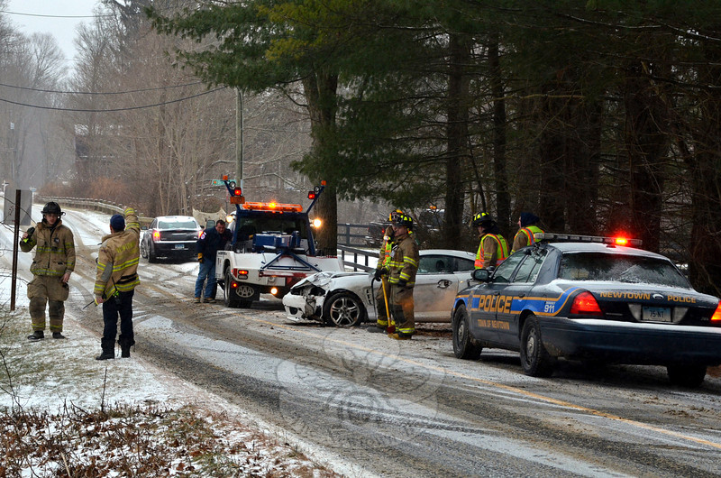 Police report that at about 11:38 am on January 2, during slippery conditions, motorist Samantha Crawford, 17, of 6 Wentworth Drive, who was driving a 2005 Hyundai Tiburon coupe southward on Poverty Hollow Road near its intersection with Equestrian Ridge Road, lost control of the vehicle, went into a spin and then struck some trees and fencing along the southbound road shoulder. Crawford was transported to Danbury Hospital by the Newtown Volunteer Ambulance Corps for treatment of injuries. Dodgingtown and Hook & Ladder volunteer firefighters responded to the accident. Police said Crawford received a written warning for traveling too fast for conditions. (Voket photo)