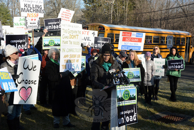 Newtown Action Alliance members held placards calling for heightened gun control at a news conference/demonstration on Monday, January 13, near the National Shooting Sports Foundation on Mile Hill Road. (Gorosko photo)