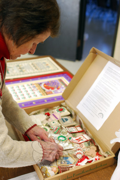"Friends of Counted Embroidery member Alma Sohle organized her ""show and tell"" hand-stitched Christmas ornaments for a meeting of the group on January 9. (Spanedda photo)"