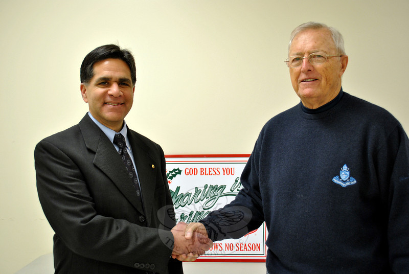 "Glenn Nanavaty, left, is congratulated on his new position as chairman of the Newtown Service Unit of the Salvation Army by outgoing chairman Dick Sturdevant, Tuesday, January 14. Mr Sturdevant served as chairman of the unit for six years, and has been involved with the group since 1998. Mr Nanavaty, who like Mr Sturdevant is a member of the Newtown Lions Club, said that he is happy ""to try to fill the tremendous shoes of Dick Sturdevant."" (Crevier photo)"