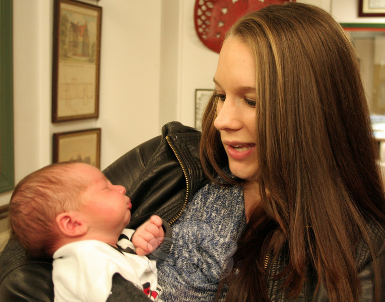 Stephanie Masciola holds her son Garrett Hydeck, Jr, born January 2 at 8:45 am, has been named The Newtown Bee's 2014 First Baby of Newtown. (Hicks photo)