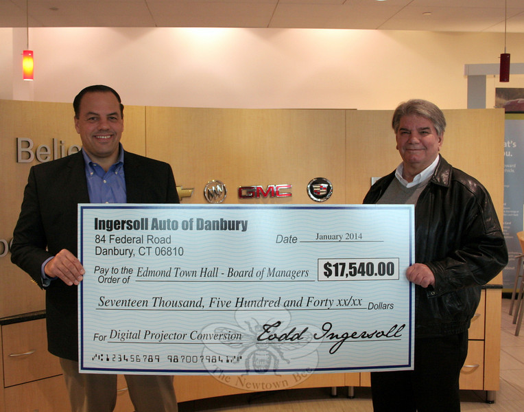 Todd Ingersoll, left, a Newtown resident and the owner of Ingersoll Auto in Danbury, presented a check for more than $17,000 to Jim Juliano, representing the Edmond Town Hall Board of Managers, on January 21. The money will be used to finish a number of projects, which will complete the restoration of the historic town hall building on Main Street. (Hicks photo)