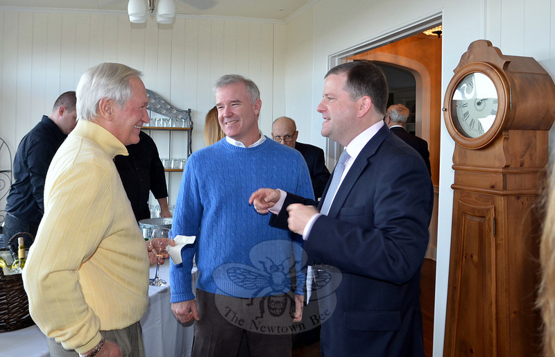 Robert Geckle, left, and former Woodbury First Selectman Gerald Stomski chat with Senator and State Senate Minority Leader John McKinney during a recent gubernatorial fundraiser hosted by Tara and John Kortze, and Kathryn Hamilton. The January 12 event was attended by several dozen local and regional Republican Town Committee members, GOP leaders, and McKinney supporters. No details were immediately available on how much McKinney raised toward his bid for the governor's seat. (Voket photo)