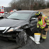 State police report that motorist Alexander Kovel, 73, of Brookline, Mass., was driving a 2012 Acura ZDX SUV eastward on Interstate 84, just east of the Church Hill Road overpass, about 1:34 pm on January 16, when the Acura drifted onto the highway's median and struck some metal flex-beam guardrailing with the driver's side of the auto. The Acura then spun out of control and struck the guardrailing again with the car's front end, state police said, coming to rest in the middle of the road with extensive damage to it. Kovel received a hand injury, but refused medical attention, state police said. Enforcement information was not available. Newtown Volunteer Ambulance Corps members and Sandy Hook volunteer firefighters responded to the incident. Karin Halstead, of the Sandy Hook unit, foreground, is seen working at the incident. (Hicks photo)