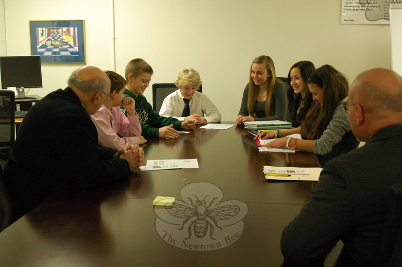 Newtown Middle School students, from left, Dylan Sock, Joshua Dunn, Daniel Grosso, Cassidy Kortze, Nicole Germak, and Romy Gold met with Interim Superintendent of Schools John Reed, left, and NMS Principal Thomas Einhorn, right. (Hallabeck photo)