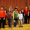 Reed Intermediate School students, not in order, Adam Guerin, Anna La Banca, Margaret O'Sullivan, Eileen McCleary, Brett Melchionno, Colin Zhang, Jackson Hebner, James Tibolla, and Cole Morelli, second from right, stand with Reed Principal Anne Uberti, right, after the school's National Geographic Geography Bee was held on Tuesday, January 14. (Hallabeck photo)