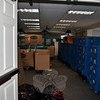 Crates packed with books from the Children's Department of the library are stacked in the Meeting Room. More books and items from that department are piled high in the Story Room and in the first floor hallway until repairs are completed. (Crevier photo)