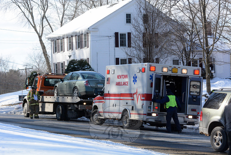 An auto wrecker prepares to haul away a vehicle that was involved in a one-car accident at about 1:01 pm on January 23 on Mt Pleasant Road (Route 6), near its intersection with Taunton Lane. Police said motorist Patricia Roche, 76, of Monroe was driving a 2005 Nissan Altima sedan eastward on Mt Pleasant Road, when while negotiating a curve in the road, she lost control of the vehicle and it spun across the roadway, striking a tree along the westbound road shoulder. The Newtown Volunteer Ambulance Corps transported Roche to the hospital for treatment of injuries, police said. Hawleyville volunteer firefighters responded to the accident. Police said the accident is under investigation. (Gorosko photo)