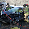 Volunteer firefighters extricated a local woman from the wreckage of a two-vehicle accident on January 23, after the sedan that she was driving on Walnut Tree Hill Road was involved in a head-on collision. Police said motorist Emily Card, 20, of 4 Deer Trail was driving a 2003 Dodge Neon sedan westward on Walnut Tree Hill Road, which then crossed over the road's centerline at about 10:46 am and collided with eastbound motorist Gerard Cole, 58, of 9 Scenic View Drive, who was driving a 2002 Chevrolet G-2500 van. The accident occurred just northeast of Walnut Tree Hill Road's intersection with Alberts Hill Road. Sandy Hook and Hook & Ladder firefighters responded to the incident. Newtown Volunteer Ambulance Corps members transported Card to Danbury Hospital for treatment of injuries, police said. Cole reported pain, but refused medical attention, police said. Police issued Card an infraction for failure to keep to the right on a curve. (Hicks photo)