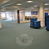 When carpet tiles are delivered, crew from J.P. Maguire will begin laying them in the now-empty Young Adult Department of the library, replacing shelving and books as they move to other areas on the second floor. (Crevier photo)