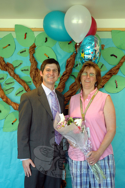 Marlene Bucci has been chosen as the district's 2014-15 Paraprofessional of the Year. Middle Gate Elementary School Principal Chris Geissler stood with Mrs Bucci on Monday, June 2, when she received flowers and balloons to mark the accomplishment. (Hallabeck photo)