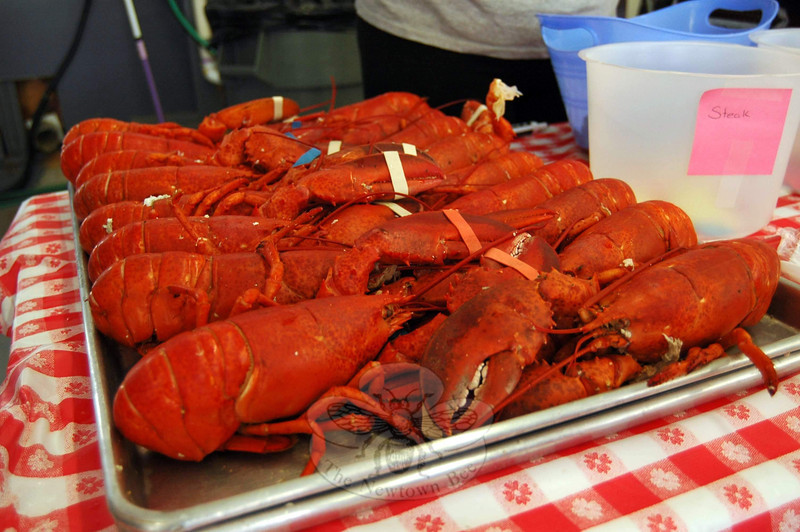 The 27th Annual Sandy Hook Lobsterfest was held on Friday, June 6, and Saturday, June 7. A total of 1,800 lobsters and more than 600 pounds of steak were served last weekend, according to LobsterFest Committee Chairman Anthony Capozziello. Guests also had the chance to purchase tickets each night, taking a chance on one of two 10-pound lobsters that were raffled. In addition, the company added a raffle of goods and services this year. Attendees could take their chance on more than 30 items and gift certificates that had been donated by local businesses. Proceeds from the event benefit the volunteer fire company, one of five that respond to Newtown's homes, businesses and roadways during emergencies.  (Hallabeck photo)